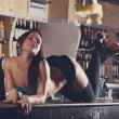Young women dancing on bar — Stock Photo