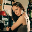 Girl with cocktail sitting in bar - Stock Photo
