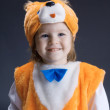 Stock Photo: Little baby girl dressed in a fox suit .