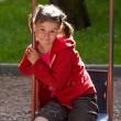 Young girl on swing outdoor — Stock Photo