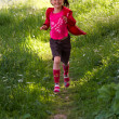 pretty young girl running in the park — Stock Photo #10773023