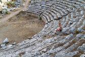 Boy in old greec amphitheater Turkey — Stock Photo