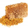 Foto Stock: Honey honeycombs and pollen