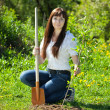 Female gardener planting tree — Stock Photo #11498301