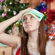 Woman in christmas hat having hangover - Stock Photo