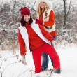 Girls plays in winter park — Stock Photo #11498349
