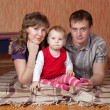 Stock Photo: Parents and child at home