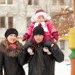 Parents with toddler  in winter — Stock Photo