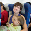 Mother and child traveling on airliner — Stock Photo