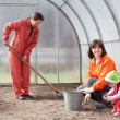 Women with child works at hothouse — Stock Photo #11498617