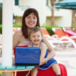 Happy mother and toddler with laptop — Stock Photo