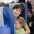 Family traveling on commercial airliner — Stock Photo