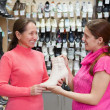 Stock Photo: Two women at shoes shop