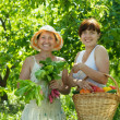 Happy women with vegetables in garden — Stock Photo