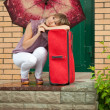 Happy woman with luggage — Stock Photo