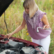 Stock Photo: Womwith her broken car