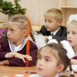 Schoolchildren in their first lesson — Stock Photo
