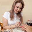 Stock Photo: Manicurist working with female nails