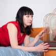 Woman with  parrot at home — Stock Photo