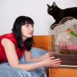 Woman with cat and parrot — Stock Photo