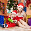 Stock Photo: Woman and boy dressed like Santa Claus