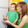 Mother teaches child — Stock Photo #11499365