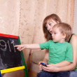 Mother teaches child — Stock Photo