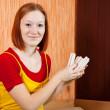 Foto de Stock  : Girl holding an energy saving bulbs