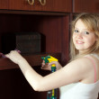 Girl cleans furniture at home — Stockfoto #11499409