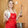 Stock Photo: Happy woman with saucepan
