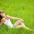 Teen girl lying in grass — Stock Photo