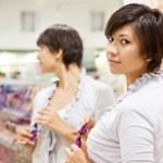 Woman at cosmetics shop — Stock Photo