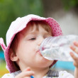 Baby drinks from plastic bottle — Stock Photo #11499532