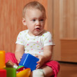 Tranquil baby  plays with toys — Stock Photo