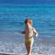 Happy toddler on sand beach — Stock Photo #11499552