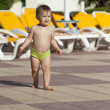 Toddler at resort hotel area — Stock Photo #11499555