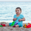 Toddler on sand beach — Stock Photo #11499557