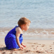 Girl on sand beach — Stock Photo #11499558