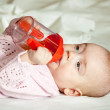 Royalty-Free Stock Photo: Baby girl  with sippy cup