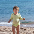 Toddler walking on sand beach — Stock Photo
