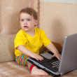 Royalty-Free Stock Photo: Little girl sitting with laptop