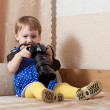 Baby girl takes photo with camera — Stock Photo