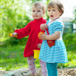 Stock Photo: Two girls in sandbox