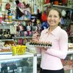 Mature woman buying lipstick — Stock Photo