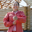 Happy  woman against  building residence — Stock Photo #11499647
