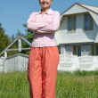 Happy woman against her home — Stock Photo #11499648