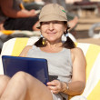 Mature woman with laptop at resort — Stock Photo #11499655