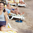 Mature woman with laptop at resort — Stock Photo #11499657