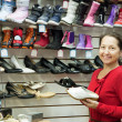 Stock Photo: Mature womchooses shoes