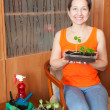 Female gardener with seedlings — Stock Photo #11499668
